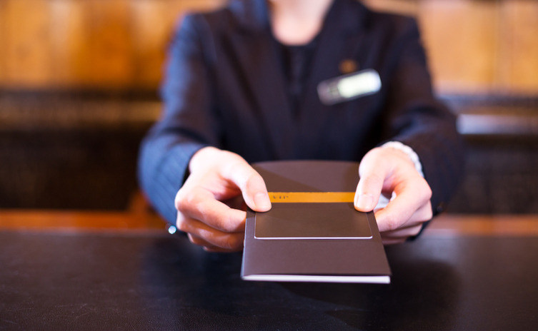 hand with credit card in luxury hotel