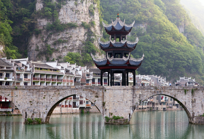 Ancient Pagoda at the bridge in ancient Zhenyuan town on Wuyang River in Guizhou Province, China