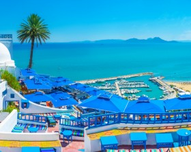 Sidi Bou Said, Tunisia - August 31, 2015: Sidi Bou Said boasts luxury restaurants and amazing viewpoints, overlooking its beaches, port and Cap Bon, seen on horizon, Tunisia.