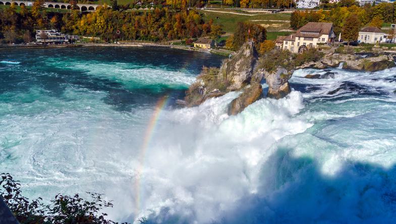 The Rhine Falls near Zurich at Indian summer, largest waterfall in Switzerland