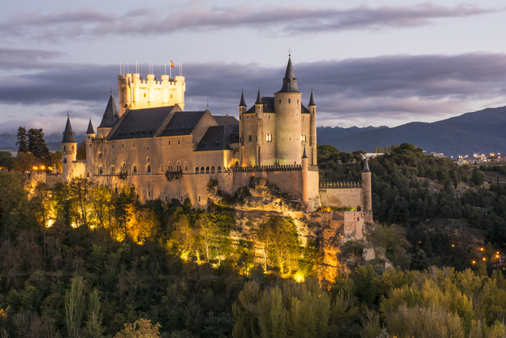 Segovia, Spain - November 6, 2016: The magnificent Alcazar of Segovia (Spain). Austere, as were the Castilian kings, high on the rock at the confluence of the valleys of the Eresma and Clamores, it seems to save the city.