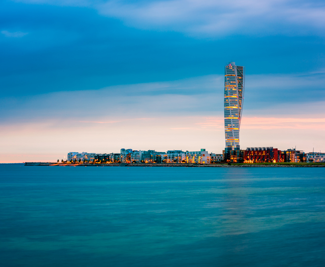 Skyline of Malmo Sweden with Famous Turning Torso Building, captured around sunset.