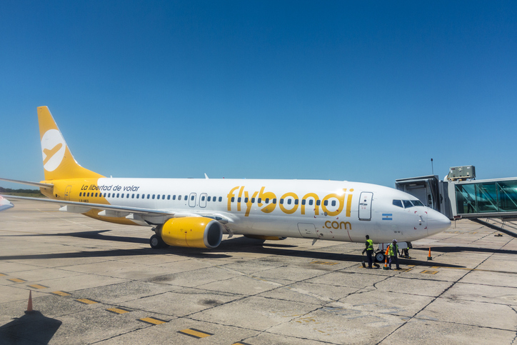 MENDOZA, ARGENTINA - FEB 12, 2018:   maintenance people prepare the aircraft of airline flybondi at the airport of Mendoza for take off.