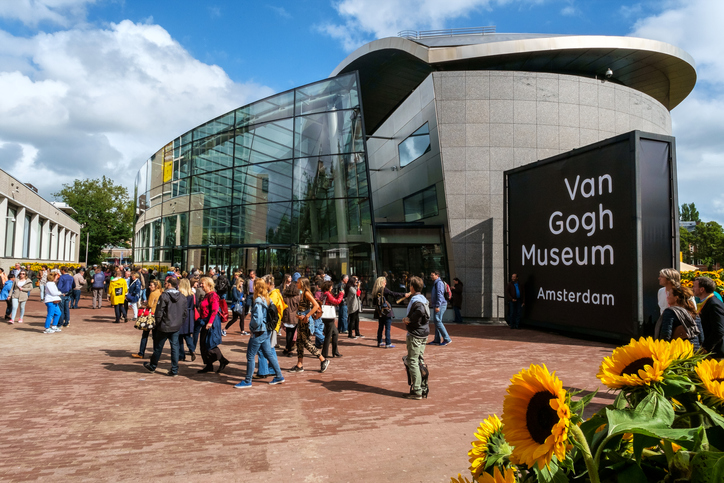 Amsterdam, the Netherlands, September 5, 2015: people in front of the new wing of the Van Gogh Museum with sunflowers