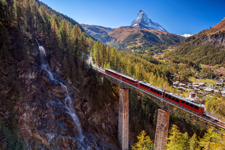 Image of Swiss Alps with Gornergrad tourist train, waterfall and Matterhorn in Valais region.