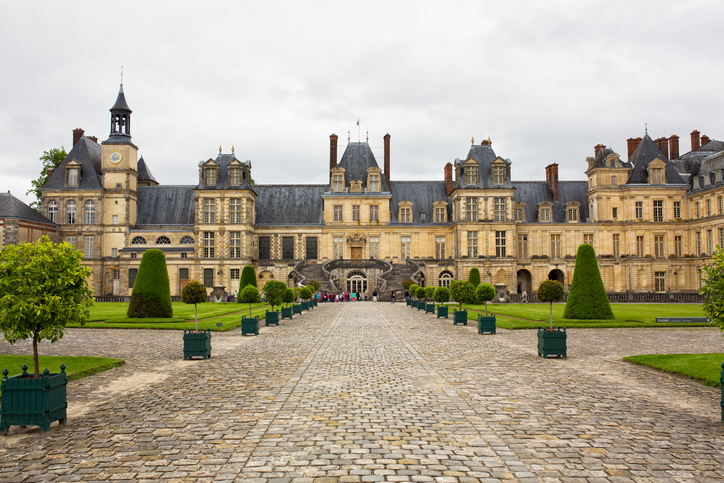 FONTAINEBLEAU, SEINE-ET-MARNE, FRANCE, MAY 2016. View of the historical Palace of Fontainebleau. Fontainebleau Palace. Built by French royalty, with parts dating back to the 1100s, the palace houses Marie Antoinette's Turkish boudoir, the Napoleon Museum and a lavish theater.