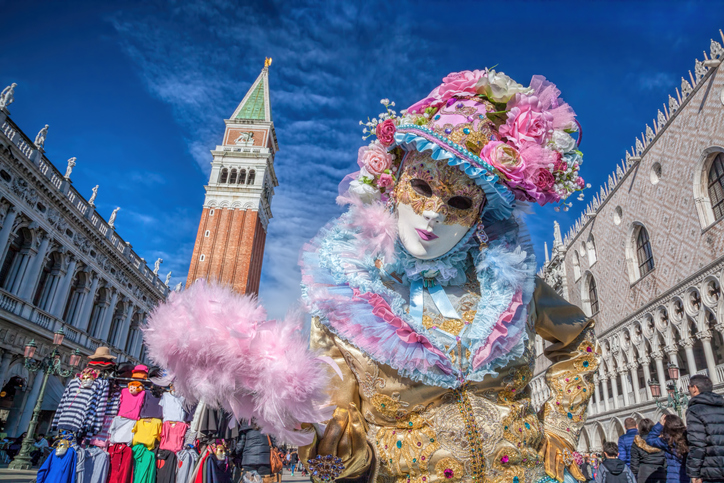 Venetian costumes pose on St. Mark square during the Venice Carnival days. The most  famous festival in the world.