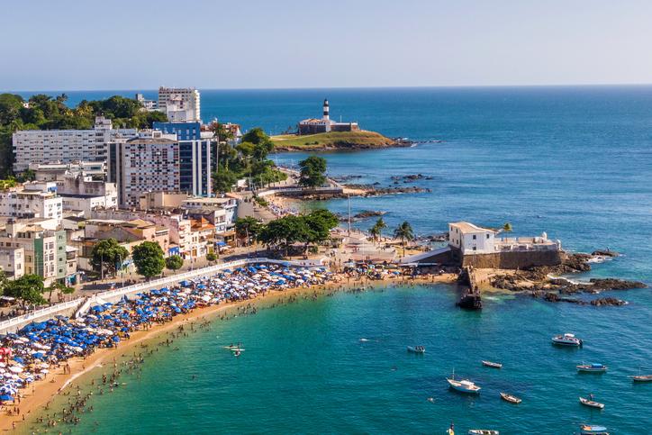 Aerial view of Salvador, Bahia, Brazil, including Porto da Barra beach and historical landmarks Barra Lighthouse and Santa Maria Fort during summer.