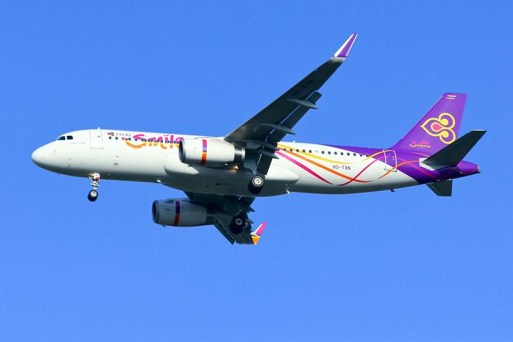 Chiangmai, Thailand - September 24, 2014: HS-TXN Airbus A320-200 of Thaismile airway. Landing to Chiangmai airport from Bangkok Suvarnabhumi.