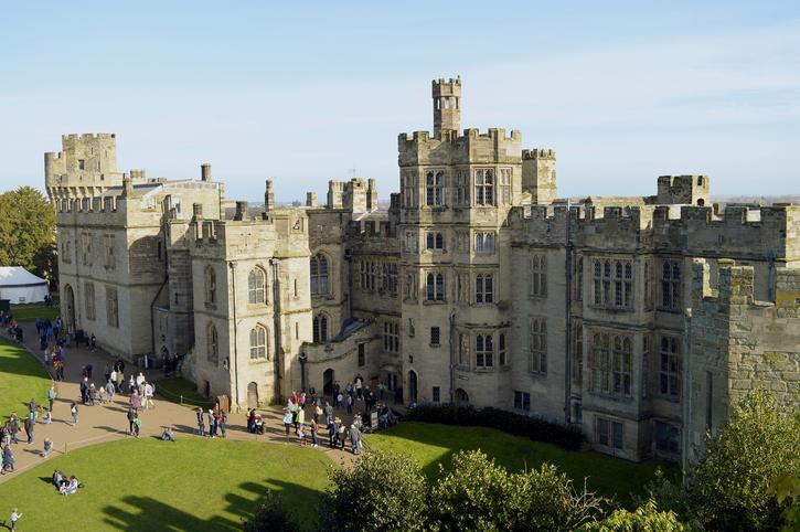 Warwick, Warwickshire, England, United Kingdom - February 22, 2019 : The historical medieval Warwick Castle in Warwickshire viewed from Ethelfleda's Mound
