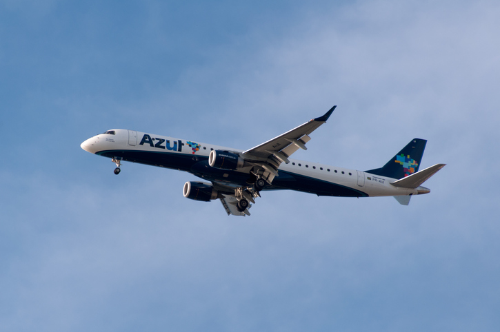 Rio de Janeiro, Brazil - October 8, 2015: Azul airlines aircraft Embraer 195 is taking off from Santos Dumont airport in Rio de Janeiro. Azul is Brazilian low cost carrier.