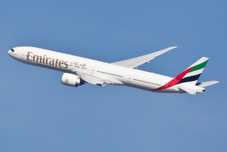New York, USA - January 28, 2012: Boeing 777 Emirates arriving at John F. Kennedy International Airport in New York on January 28, 2012. Boeing 777 is the largest airplane powered by two engines.