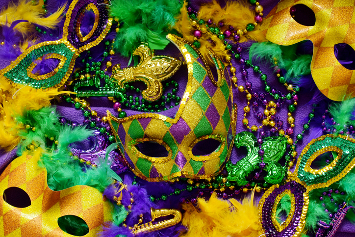 Colorful masks and decorations on a purple background