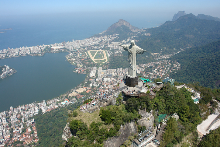 """Rio de Janeiro, Brazil – September 14, 2007: Statue of Christ the Redeemer a top Corcovado Mountain, the historic monument of Brazil most visited by foreign tourists and Brazilians, which is positioned between """"The 10 Wonders of the World"""""""