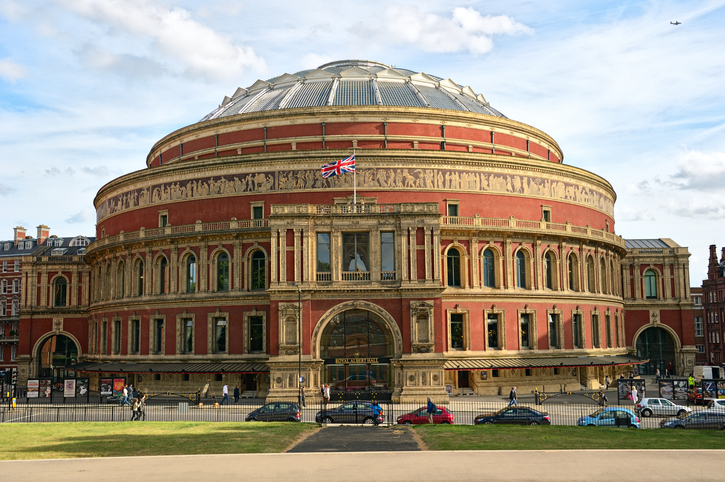 """""""London, England, UK aA May 22, 2011: Royal Albert Hall, a British event venue dedicated to promoting understanding and appreciation of the arts and sciences, best known for hosting the Proms each summer.  One of the most famous venues in the world, the Hall presents a diverse, continuous programme of the best known performers in a range of genres from classical music concerts to rock and pop, from opera and ballet to circus, from community events to tennis."""""""