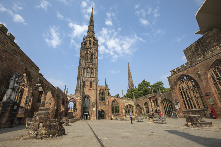 Coventry, UK - July 26th 2018: The historic Coventry Cathedral, also known as St. Michaels, which was destroyed during a bombing raid by the Luftwaffe in the Second World War and is now a ruin open to the public.