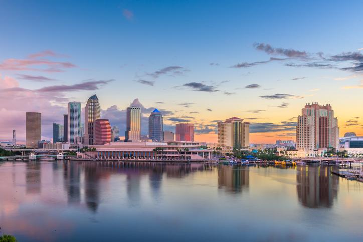 Tampa, Florida, USA downtown skyline on the bay at dawn.
